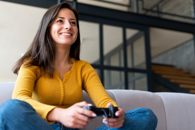 Woman having fun playing video games