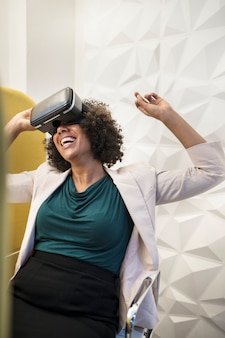 Woman having fun with a vr set