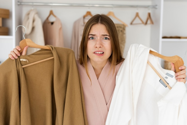 Woman having a hard time deciding what to wear