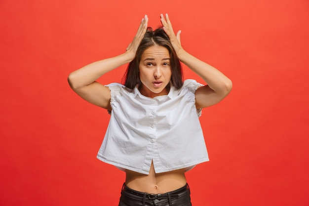 Woman having headache. isolated over red background.