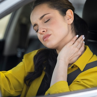 Woman having neck pain from the driving