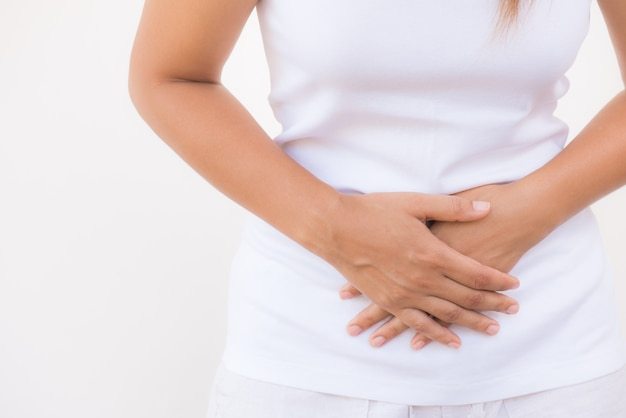 Woman having painful stomachache. chronic gastritis. abdomen bloating concept.