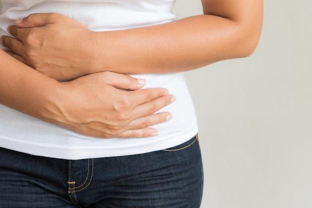 Woman having painful stomachache. chronic gastritis. abdomen bloating concept.