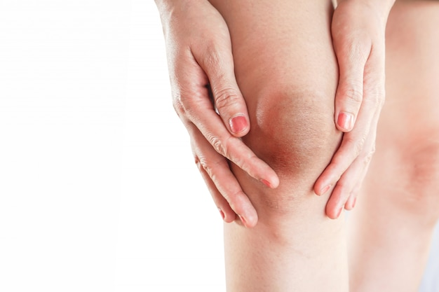 Woman having problem with dark and wrinkle skin on knee
