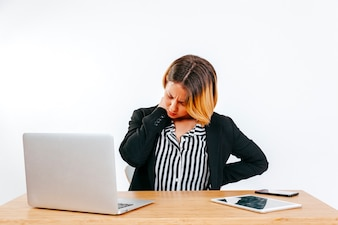 Woman having problems with spine at work