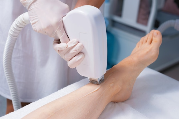 Woman having a procedure of laser hair removal