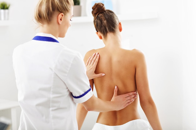 A woman having professional back therapy