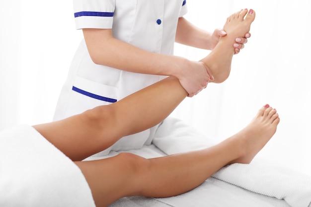 A woman having professional leg therapy
