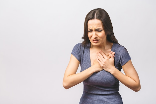 Woman having severe chest pain as heart attack and illness concept