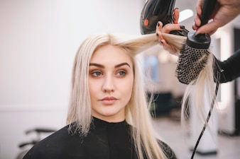 Woman having styling procedure in parlor