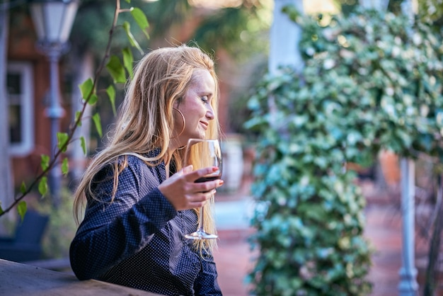 Woman having a wine on a terrace