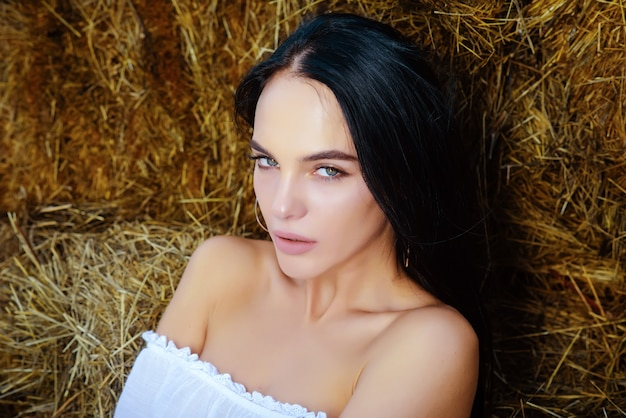 Woman on hay beautiful young woman outdoors beauty portrait