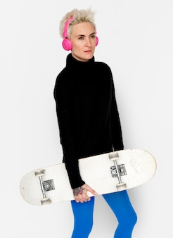Woman headphone sketeboard lifestyle concept