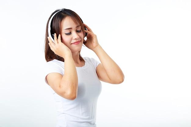 Woman headphones listening music on white