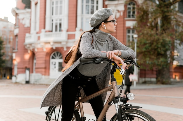 Woman and her bike in the city