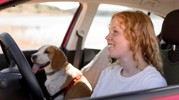Woman and her dog in the car