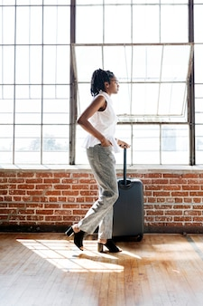 Woman and her luggage getting ready for a trip
