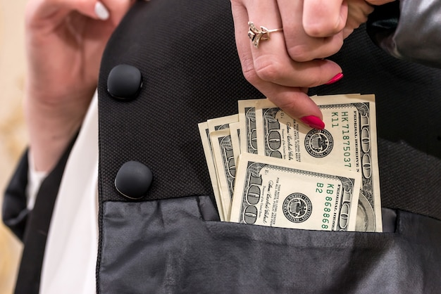 Woman hiding dollars into the jacket