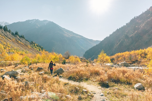 Woman hike through mountain and beautiful nature of forest.