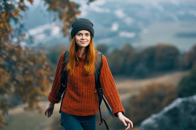 Woman hiker backpack landscape vacation lifestyle. high quality photo