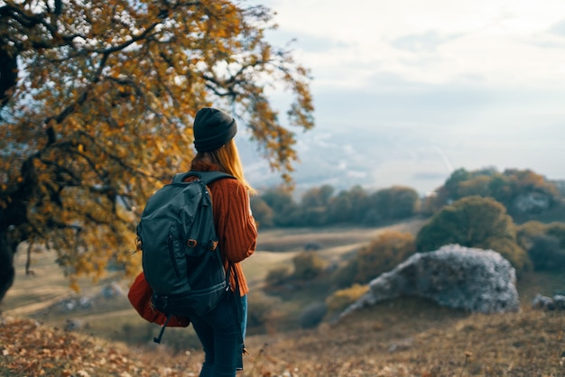 Woman hiker backpack in travel mountains autumn lifestyle