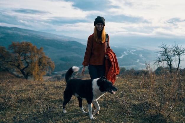 Woman hiker dog walking nature mountains landscape