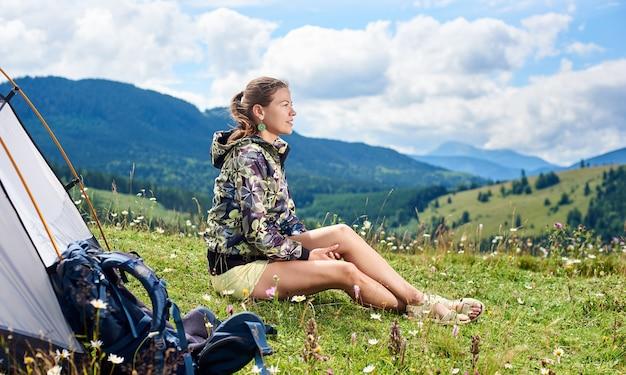 Woman hiker hiking in mountain trail