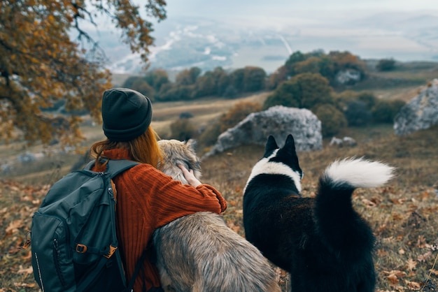 Woman hiker in nature with dogs adventure travel