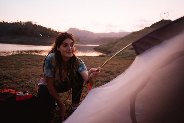 Woman hiker prepare make a tent