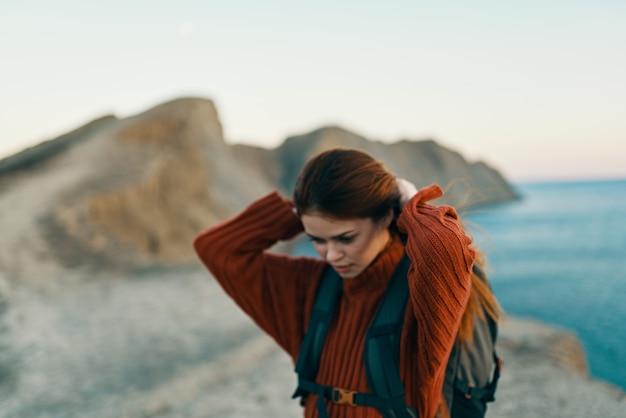 Woman hiker rocky mountains landscape sunset freedom