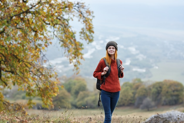 Woman hiker travel in the mountains autumn trees vacation