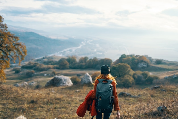 Woman hiker travel mountains landscape autumn trees