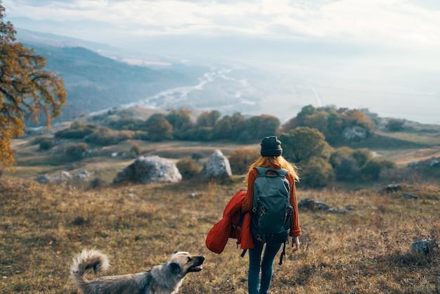 Woman hiker walking dog mountains landscape fresh air nature