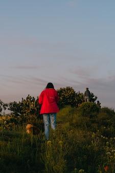 Woman hiking with her dog. Premium Photo