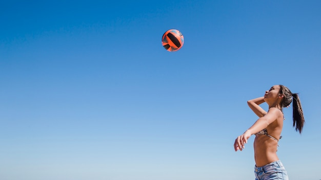 Woman hitting volleyball
