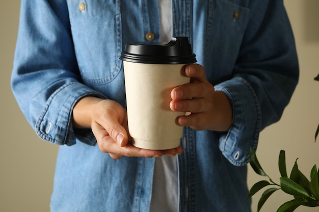 Woman hold blank paper cup