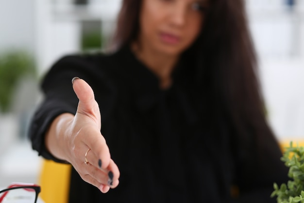 Woman hold document pad give arm as hello in office