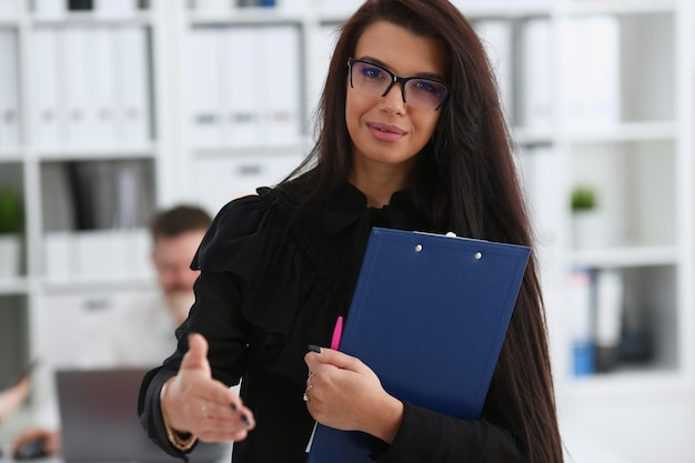 Woman hold document pad give arm as hello