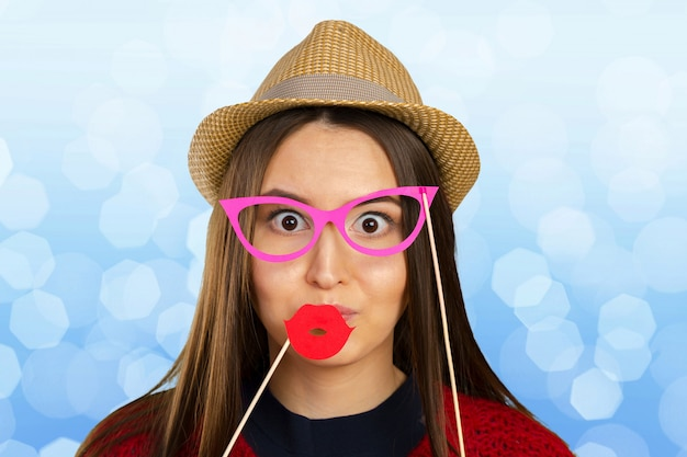 Woman hold photo booth prop