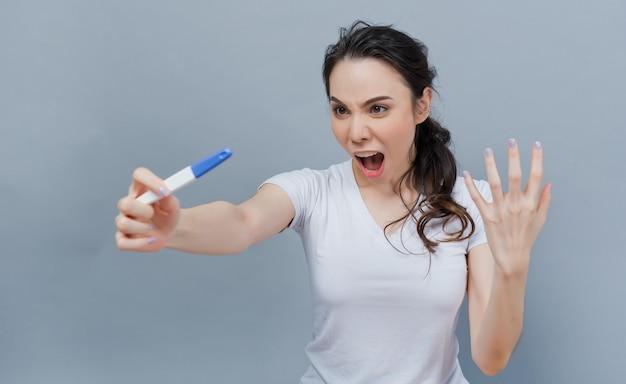 Woman hold pregnancy test kit, pregnant women