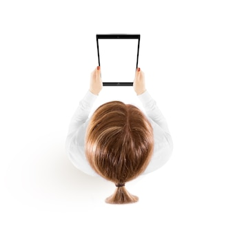 Woman hold tablet pc mockup in hand top view
