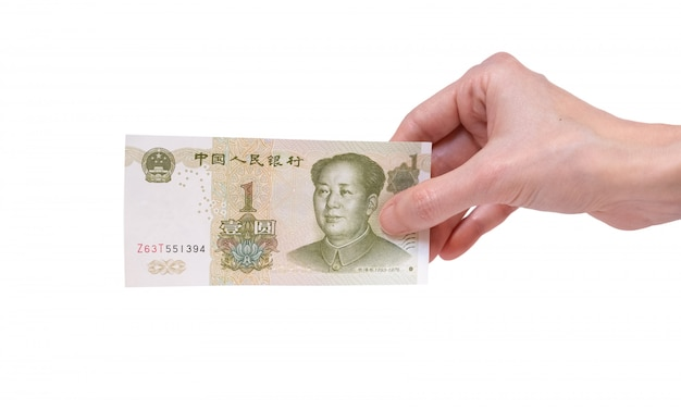 Woman holding a 1 chinese yuan banknote in her hand on a white