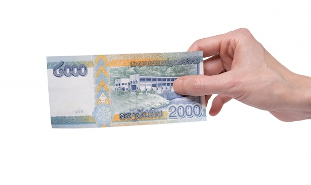 Woman holding a 2000 kip banknote in her hand on a white
