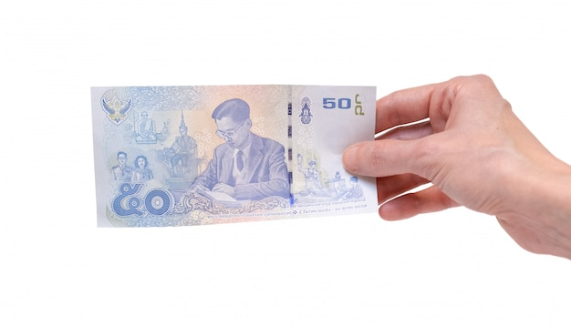 Woman holding a 50 thai baht banknote in her hand on a white