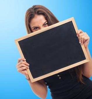 Woman holding a blackboard