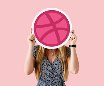 Woman holding a Dribbble icon