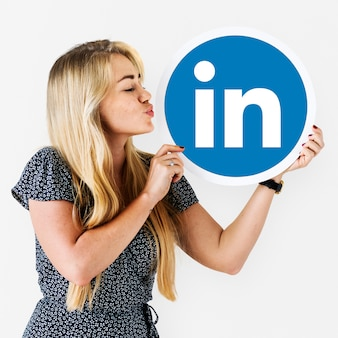 Woman holding a Linkedin icon