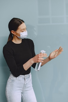 Woman holding antiseptic in her hands