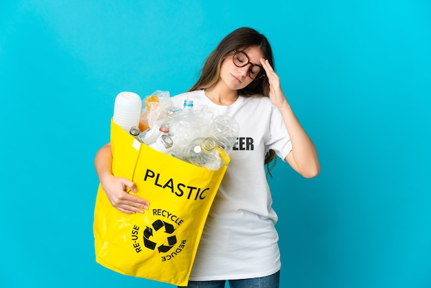 Woman holding a bag full of bottles to recycle isolated