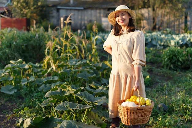 Woman holding a basket with a harvest of vegetables in her hand.